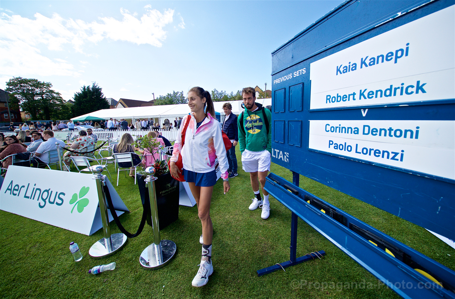 LIVERPOOL, ENGLAND - Thursday, June 20, 2019: Corinna Dentoni (ITA) and Paulo Lorenzi (ITA) walk out for their doubles match during the Liverpool International Tennis Tournament 2019 at the Liverpool Cricket Club. (Pic by David Rawcliffe/Propaganda)