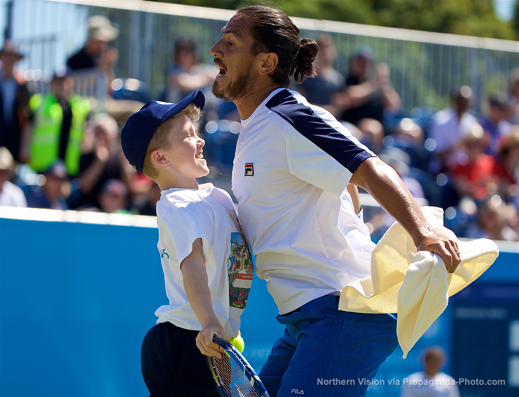 LIVERPOOL, ENGLAND - Saturday, June 17, 2017: A ball boy chest bumps Guillermo Cañas (ARG) plays a point on his behalf of during Day Three of the Liverpool Hope University International Tennis Tournament 2017 at the Liverpool Cricket Club. (Pic by David Rawcliffe/Propaganda)